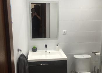 bathroom remodeled sink mirror toilet marbella homes